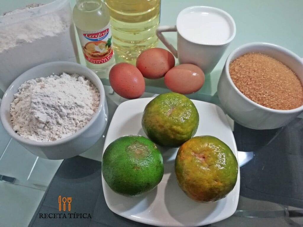 Ingredientes para preparar torta de mandarina: Mandarinas, azúcar, huevos, leche, aceite, esencia, harina.